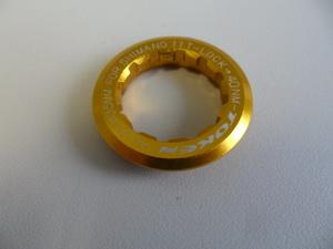 Token Гайка стопорная для кассеты на 11зуб AL-6061 золотая TK041S